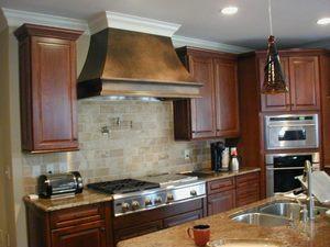 Нужно ли ставить вытяжку на кухне с электроплитой