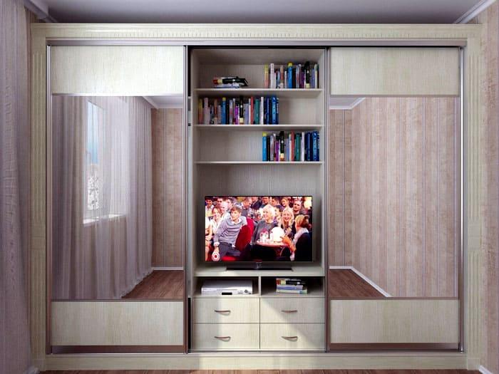 Во внутреннюю секцию возможно даже вмонтировать телевизор, если его нужно скрыть по условиям стиля помещения.Можно сразу найти модель с открытой секцией под книжные полки и телевизор