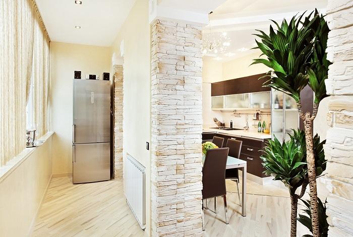 Площадь кухни увеличена при помощи соединения её с лоджией.