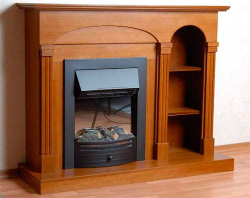 Деревянные порталы для электрокаминов смотрятся дорого и придают изящества интерьеру
