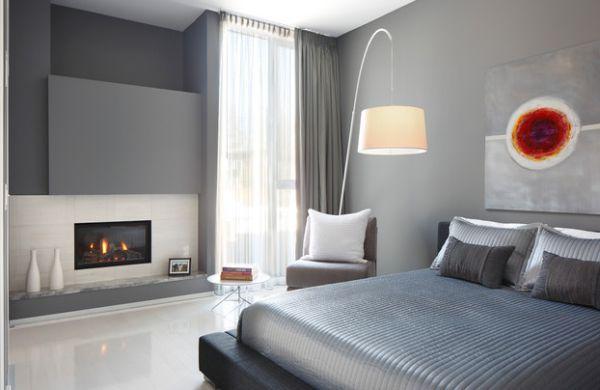 Элегантное оформление спальни с камином