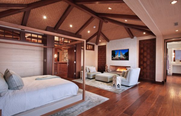 Роскошное оформление спальни с камином